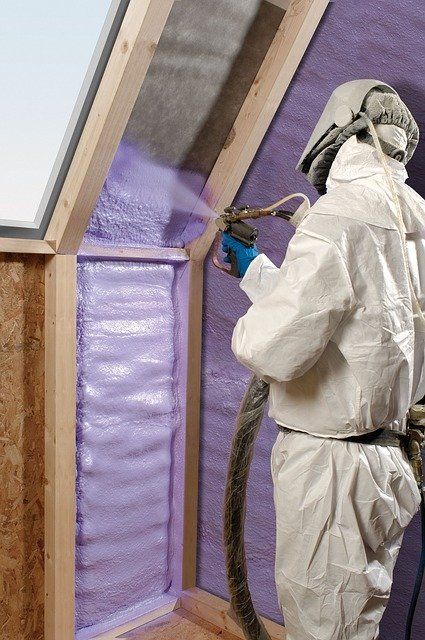 man installing spray foam insulation